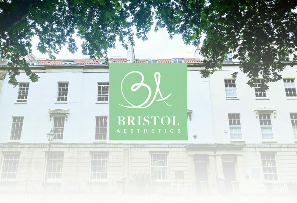 Bristol Aesthetic Logo with building in the background